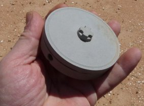 an M969 mine held in my hand